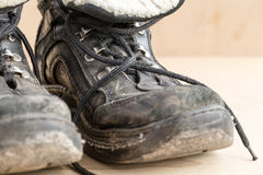 Dirty shoes after hiking on rough terrain. Stock Photography
