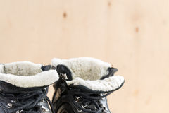 Dirty shoes after hiking on rough terrain. Stock Image