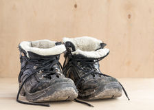 Dirty shoes after hiking on rough terrain. Royalty Free Stock Photo