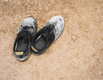 Dirty Shoes Sneaker on Ground surface Stock Image