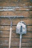 Dirty shovel and a rake Royalty Free Stock Image