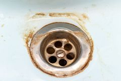 Free Dirty Sink Drain Mesh, Hole With Limescale Or Lime Scale And Rust On It Close Up, Dirty Rusty Bathroom Washbowl Stock Photography - 150667852