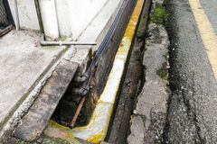 Dirty smelly clogged polluted drain poses hygiene and health ris Stock Images