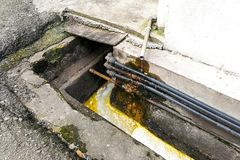 Dirty smelly clogged polluted drain poses hygiene and health ris Royalty Free Stock Photos