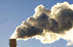 Dirty smoke. Coming from factory chimney, ecology problems Stock Photo