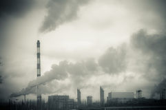 Dirty smoke produced by chemical factory Stock Image