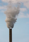 Dirty smoke from a tall chimney Stock Photos