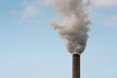 Dirty smoke from a tall chimney Stock Photography