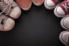Dirty sneakers in circle for copy space Royalty Free Stock Photos