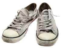 Dirty sneakers isolated. On a white background stock image