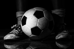 Dirty sneakers with soccer ball Stock Photography