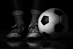 Dirty sneakers with soccer ball Stock Photo