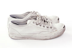 Dirty sneakers in white_sideway. Pair of used sneakers  in white background Stock Images