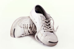 Dirty sneakers in white royalty free stock photos
