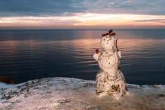 Snowman at sea royalty free stock photos