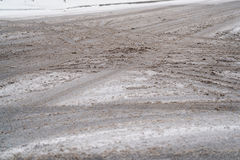 Dirty snow on town intersection Royalty Free Stock Photo