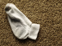 Dirty sock on the floor Stock Image