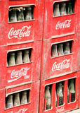 Dirty Soda. Dirty Coca Cola bottles in crates on the side of the road Stock Image