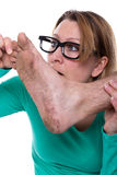 Dirty sole of a foot. Woman looks at the dirty foot of a man Royalty Free Stock Photos
