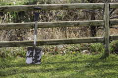 Dirty spade on the wood fence and grass. Gardening tool Royalty Free Stock Photography