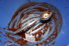 Dirty Spoon in Bowl Royalty Free Stock Images
