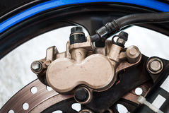 Dirty Sport Bike's Disc Brake with Calipers Stock Photo