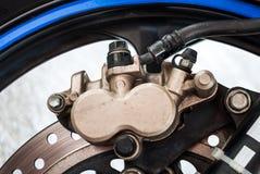 Dirty Sport Bike's Disc Brake with Calipers Stock Photo