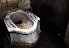 Dirty squat type toilet Stock Photo