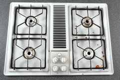 Dirty Stove Top. The top of four gas burners showing it needs to be clean Royalty Free Stock Photo
