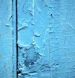 dirty stripped paint in the blue wood door and rusty nail Royalty Free Stock Photos