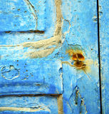 dirty stripped paint in the blue wood door and rusty nail Royalty Free Stock Images