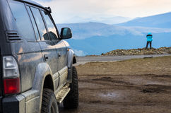 Dirty suv on mountain Royalty Free Stock Images