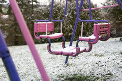Dirty swing covered in snow Royalty Free Stock Photos