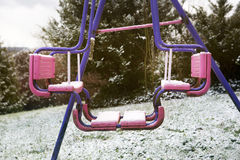 Dirty swing in the snow Royalty Free Stock Photo