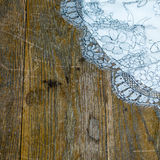 Dirty Table with Lace (1). Marked & Scratched Wooden Table with White Lace Tablecloth Royalty Free Stock Photos