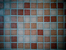 Dirty, tiled old mosaic wall, soft focus Stock Images