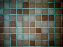 Dirty, tiled old mosaic wall, soft focus Stock Image