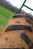 Dirty tire tread. A close up of a dirty tire with mud in it's tread royalty free stock photography