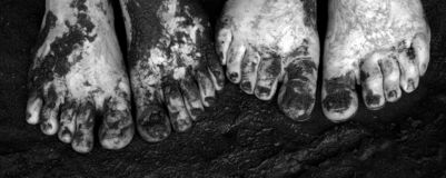 Dirty toes. Muddy feet Stock Photos