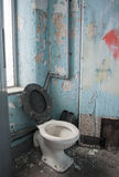 Dirty toilet in derelict victorian mill Stock Photo