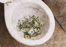 Dirty toilet with money Stock Photos