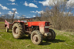 Dirty tractor on a field Royalty Free Stock Photo