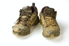 Dirty trainers. On a white background Royalty Free Stock Photo
