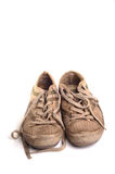 Dirty Training Shoes. Photograph ofa pair of well used and gruby trainers, shot in studio against a white background Royalty Free Stock Image