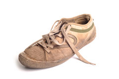 Dirty Training Shoes. Photograph of a well  used and gruby trainer, shot in studio against a white background Royalty Free Stock Image