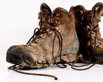 Dirty trekking boots. Worn and dirty high-altitude trekking boots Stock Images