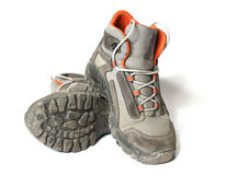 Dirty trekking shoes Stock Images