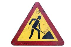 Dirty triangular red border yellow road sign `Road works` isolat. Ed on white royalty free stock photography
