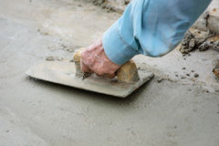 Dirty trowel with hand plastering cement mortar Stock Image