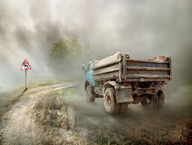 Dirty truck on a country road Stock Images